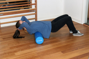 Foam rolling the thoracic spine muscles (mid back muscles)